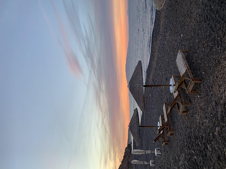 Dreamy sunset meditation by the beach with wine 2