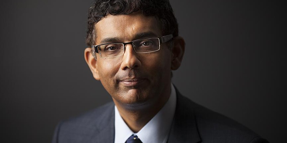 becoming american by dinesh d souza The vero beach prayer breakfast dinesh d'souza applying the hardboiled perspective that he learned in confinement to american politics, d'souza saw.