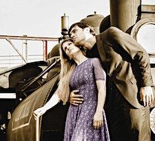 John e Carol Bassi - Praise Cia. de Dança / ZOE Dance logo