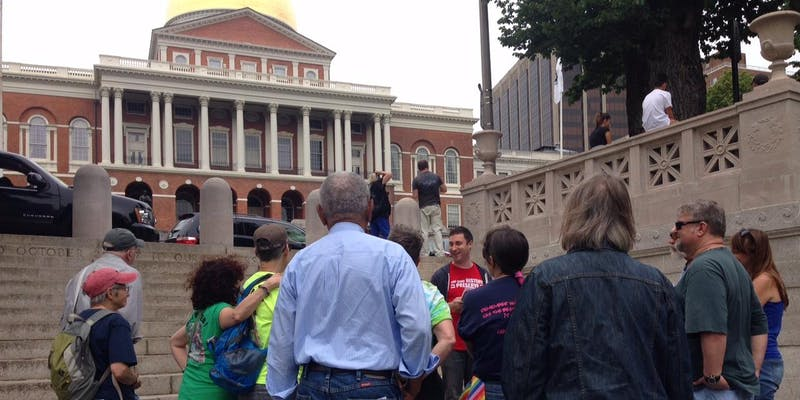 THP co-chair Andrew Elder elads a walking tour, in fron of massachusetts state house