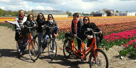 Keukenhof flower field bike tour +visit tulip farm tickets