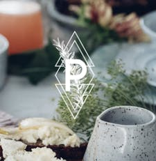 PURSUITS IN FOOD logo