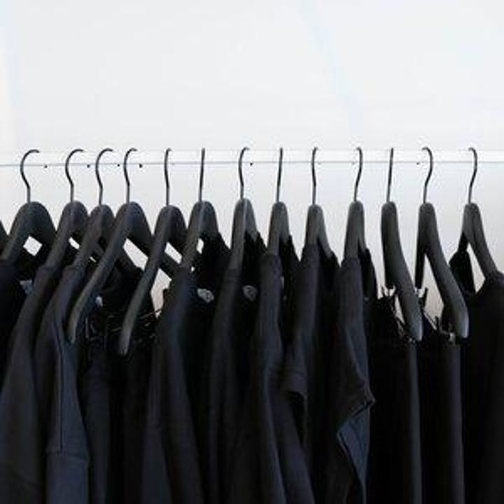 Dark clothing hanging from a white hanger