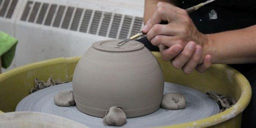 Throwing Clay on the Pottery Wheel