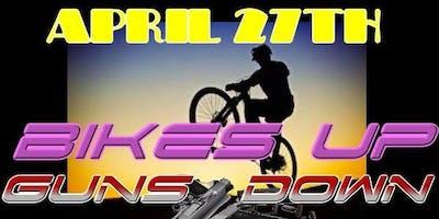 Bikes Up Guns Down