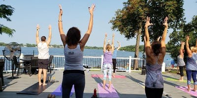Bellinis, Beer & Yoga on the deck at Sunset Pavilion located at Breezewald Park