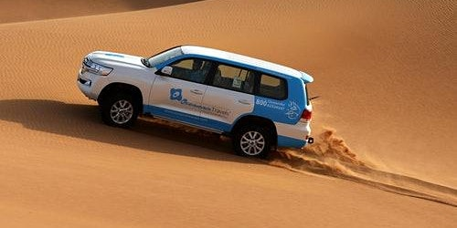 Desert Morning Safari with Camel Ride and Sandboarding