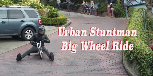 DareDevil Urban Stuntman rides a Big Wheel on Venice Blvd