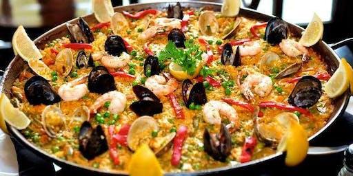 Spanish Paella Cooking Class with Paella Dinner, Tapas, Sangria, & Dessert