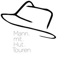 Mann mit Hut Touren