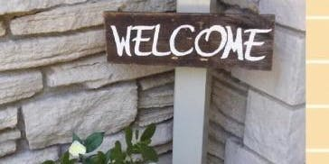 Fence Post welcome sign