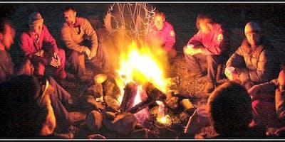 Men Sitting By A Fire Summer 2019