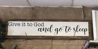 Give it to God above the bed sign