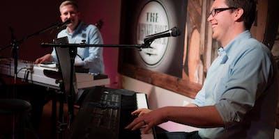Sam and Adam's Dueling Pianos