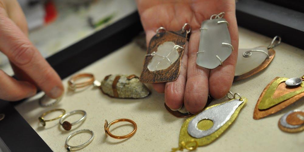 hands showing mandmade jewellry