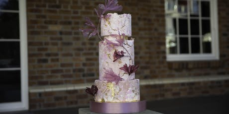 Aged stone and florals cake decorating hands on class tickets
