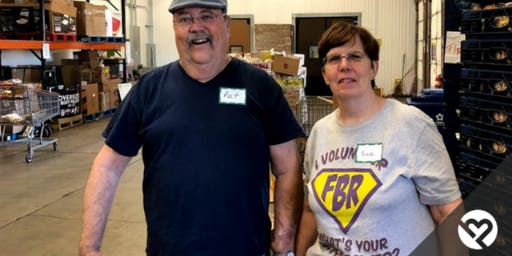 Volunteer with Project Helping to Distribute Food to Low-Income Seniors at Food Bank of the Rockies