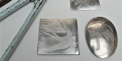 Pewter brooch making.