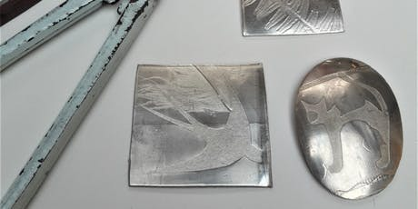 Pewter brooch making. tickets