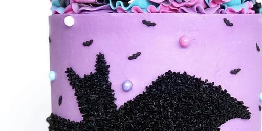 Halloween sprinkle bat cake decorating class