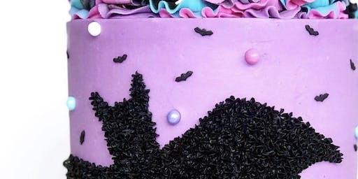 Halloween sprinkle bat cake decorating class