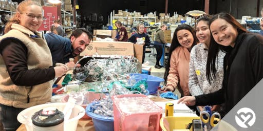 Volunteer with Project Helping to Prepare and Pack Medical Supplies for Villages All Over the World