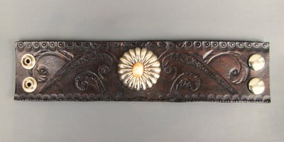 Leather Adorned Embossed Cuffs