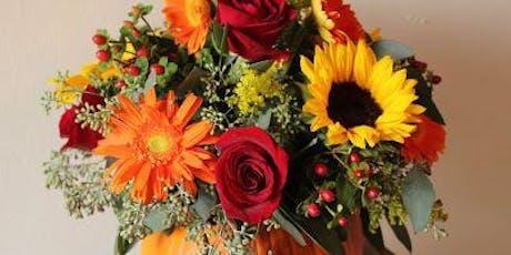 DIY Thanksgiving centerpiece: flowers in the pumpkin tickets