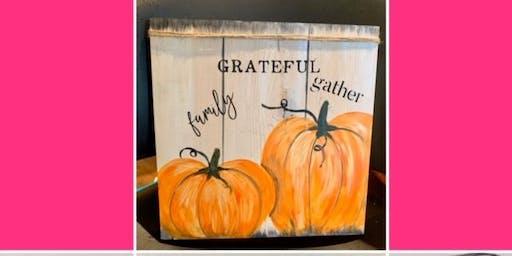 Pumpkins on wooden plank @ Kingpin Hope