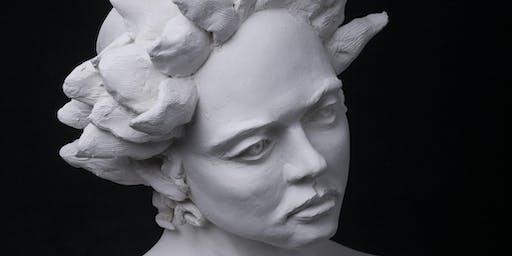 Sculpt a portrait in clay