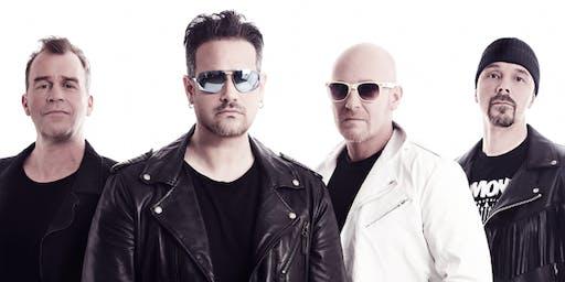 U2 fly im Saal Zum Pitt
