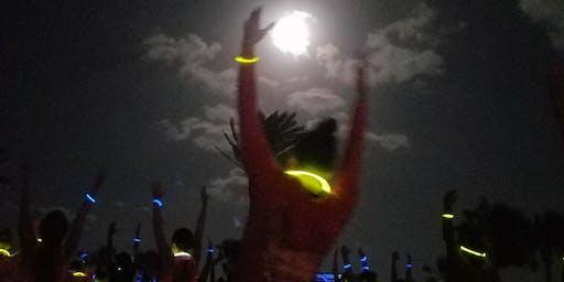 Spooky Stretch GLOW YOGA at the Beach