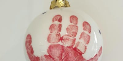 Baby hand and footprints onto ceramic baubles