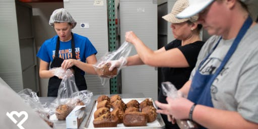 Volunteer with Project Helping to Prepare Bread to Support Individuals in Recovery (Treasure House of Hope)