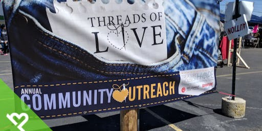 Volunteer with Project Helping to Help Build Clothing Racks to Distribute Coats to those in Need (Treasure House of Hope)