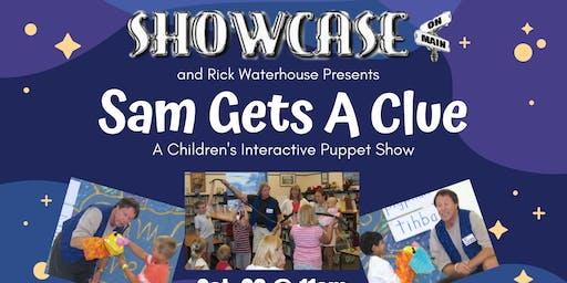 Sam Gets A Clue at Showcase on Main