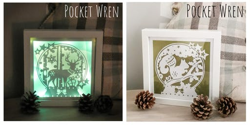 Light up Papercut Snow Globe frames.