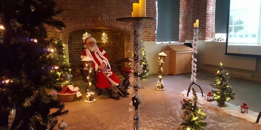 Meet Father Christmas in his Woodland Grotto