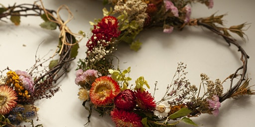 Making a wreath from twigs, dried flowers and grasses