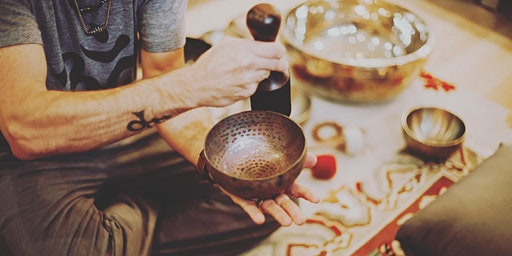 Singing bowl sound healing session at altar.