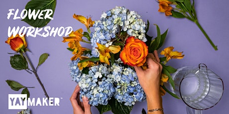 Flower arrangement and sip party tickets