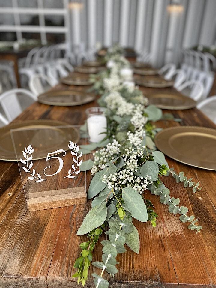 eucalyptus garland on farm table for wedding