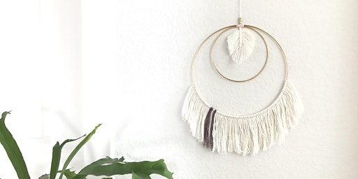 Macrame wall hanging with rings